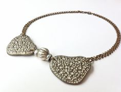 Unique wedding, eco friendly, necklace.  This necklace features two paper pulp centerpieces, engraved, painted and decorated with metallic acrylic colors. Very durable and would last for many years. Most important, it is very light !!! Dafna Yarom http://ygil76.wix.com/paper-drawings #Paper jewelry #Weddingnecklace