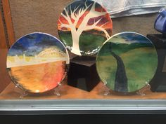 Plates using paper stencils and under glaze. Seaman High School.