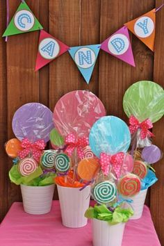 This is perfect!!!!  Hand make the large lollipop and personalize with pics of birthday girl and age, then add real lollipops around for favors!