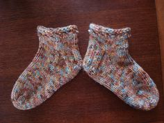 This is a good pattern for those for beginning knitters who want to be initiated into the wonders and joys of knitting socks. Knit in a chunky yarn on size 5mm needles, they don't take much time, yarn or even effort. The following pattern is for an ankle sock which can be used as a bed sock. If you want a sock with a longer leg, add one more ball of yarn – bringing the total to three.
