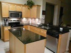 oak cabinets with granite countertops | absolute black granite
