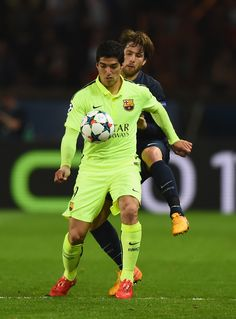 Luis Suarez of Barcelona is tackled by Maxwell of PSG during the UEFA Champions League Quarter Final First Leg match between Paris Saint-Germain and FC Barcelona at Parc des Princes on April 15, 2015 in Paris, France.