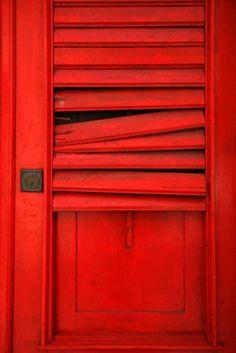 Imperfect Red Shutter Door