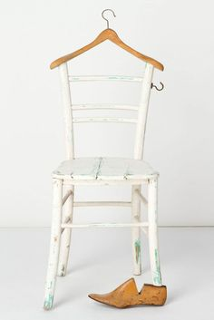 Simple DIY: Add a wooden hanger & a hook to an old chair for hanging a coat and tie. Love it!