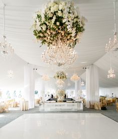white dance floor and chandeliers