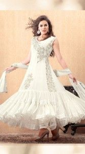 white georgette salwar kameez is adorned with stone