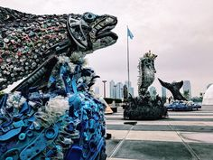 A nine-foot-tall whale tail, a six-foot-long salmon, and a ten-foot-tall seahorse, all made from trash, grab your attention as you enter the #UnitedNations Headquarters in #NYC. Every piece of these sculptures was once purchased by someone, discarded, became waterborne, and landed on a beach where someone else picked it up and made a difference.  These works of art were created by the non-profit organization Washed Ashore, whose mission is to use the power of the arts to educate a global…