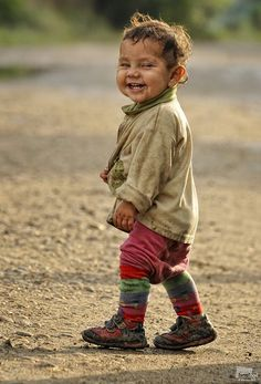 his smile is infectious! what a little cutie, just going about his business. kn