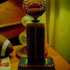 Box Tops For Education traveling trophy. Yard sale trophy covered with mardi gras beads n homemade topper.