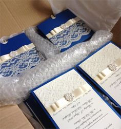 Day invitations with complimentary evening invites. Ivory lace, pearls and satin gives this wallet style invite a touch of vintage glamour