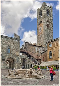 Piazza Vecchia, Bergamo, Italy. Bergamo listen is a city and comune in Lombardy, Italy, about 40 km northeast of Milan. The comune is home to over 120,000 inhabitants. Wikipedia