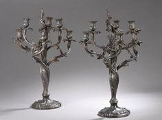 Paire de chandeliers en régule à 6 bras de lumière, modèle rocaille