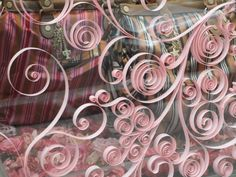 Visual Merchandising and widow display paper front of window whimsical curls to add beauty
