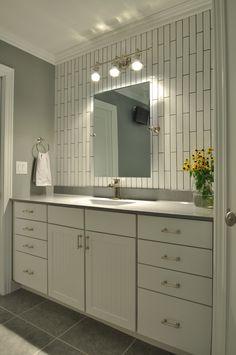 Design Idea: Vertical tile. Floating mirror. Nice sleek look.