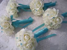 Flowers: Blue ribbon?? Cream/white Realtouch Roses wrapped in Tiffany by modagefloral, $395.00