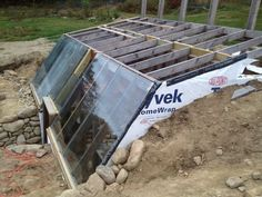 A nice page about building an in ground walapini greenhouse, again using glass instead of plastic sheet.