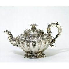 Teapot 1830-1831 (made) Silver, raised and chased, with hinged lid and ivory handle strips
