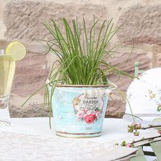 This attractive bucket can be used for many different purposes around the home complete with easy carry cork handle. Completed in fresh summer colours including duck egg blue, hints of gold, Country cream and a variety of pinks, with contrasting patterns cleverly placed creating a vintage inspired pitcher jug including a traditional stamp and postcard design faded into the polka dot background.