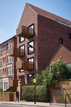 Amin Taha Architects built this gabled apartment complex in the north of London, the UK. The six apartments feature traditional brick facade and distinctive projecting wicker balconies Architecture Résidentielle, Contemporary Architecture, Architects London, Timber Structure, London Apartment, Duplex Apartment, Apartment Goals, Apartment Design, Brick Facade