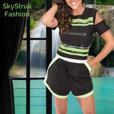 Studded Black Crop Top & Shorts Be totally unique in this awesome set this summer. Black crop top is stretchy w shiny black, silver and lime green embellishments on front. Back is solid black. Mesh in sleeves. Black wide leg shorts , white trim down sides and pockets, lime green embellishments & 1 pleat on each side of front. Zipper down back . 95% polyester, 5. % spandex Boutique Other