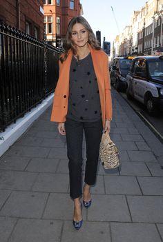 Olivia Palermo orange coat black on black polka dot shirt blak jeans