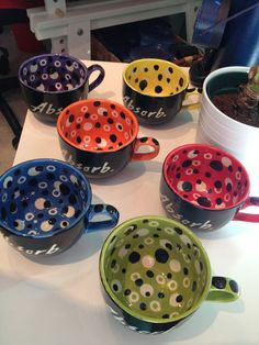 Hand painted glaze on pottery mugs #lkfdesigns - I like the solid color outside, bright pop of color inside.