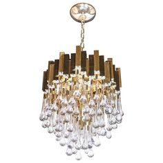 Stunning Modernist Chandelier in Brass and Crystal Droplets by Sciolari | From a unique collection of antique and modern chandeliers and pendants at https://www.1stdibs.com/furniture/lighting/chandeliers-pendant-lights/