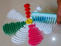 Very beautiful and colourful rangoli design using comb by DEEPIKA PANT - YouTube