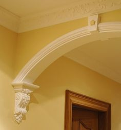 Archway with corbels. Wood corbels, hand carved with many designs, are available… Home Renovation, Home Remodeling, Arch Molding, Crown Molding, Arch Doorway, Moldings And Trim, Plaster Mouldings, False Ceiling Design, Home Upgrades