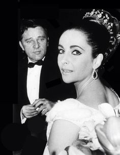 Elizabeth Taylor and Richard Burton. (What is his expression about?).