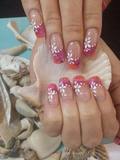 Pink and orange acrylics with inlaid shell and freehand nail art