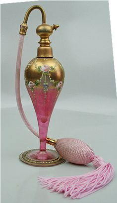 Marcfranc France Perfume Atomizer Hand Painted 1800's  This is a very unique hand painted Marfranc France perfume atomiser from the 1800's. The hand painted detail is just amazing on this piece. The glass is rose colored with gold accents and has a rose floral pattern detail throughout.