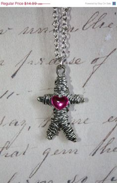 Voodoo Love Doll Necklace. I want this.