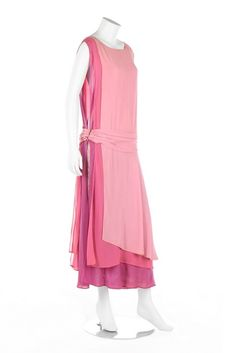 A Jean Patou couture chiffon evening gown, circa 1923-4. A Jean Patou couture chiffon evening gown, circa 1923-4. large woven label and numbered 25934, in three shades of pink and mauve, the dropped waistline with cummerbund-like integral sash, triple layered panels to skirt, with lamé panel to skirt side, the lower hem edged in pink metallic lace, bust approx 86-92cm, 34-36in. - See more at: http://kerrytaylorauctions.com/one-item/?id=59&sub=%20&auctionid=429#.dpuf