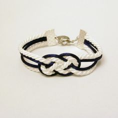 Navy and white knotted nautical rope bracelet with silver seashell charm. $13.00, via Etsy.
