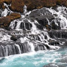 Beautiful Hraunfossar waterfall and the super blue color of the river, Western Iceland