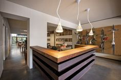 reception, with bike rack wall. Oxigen Office Design by Oxigen with Woods Bagot