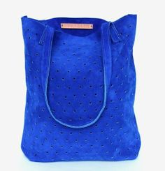 Snatch up one of these dreamy bags before they're gone. Made of sturdy suede in the most vibrant and lovely blue you've ever seen!