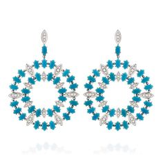 Two layers of vivid #turquoise drops are interspersed by diamond-set white #gold drops to create these enthralling Aquário hoop #earrings.@carlaamorim
