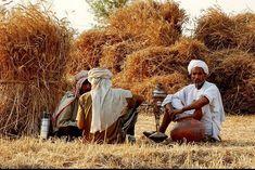Farmer relaxing smoking huqqa