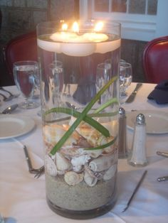 great alternative to flower centerpieces for beach themed weddings.