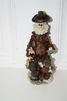 """Boyd's 'Execunick...the first global business man' figurine measures approx: 7.5"""" x 3"""" x 2 1/4"""" 'Decide what you want, decide what you are willing to exchange for it. Establish your priorities and go to work'. ed/pc# 8E/1845 style #28002 from 1998. $12.50"""