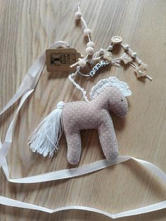 Check out this item in my Etsy shop https://www.etsy.com/listing/552761199/pinky-pony-keychain-keyholder-pendant