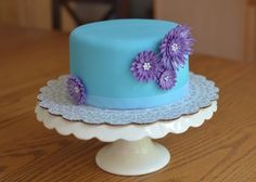"""Simple 6"""" Cakes. Blue with purple flowers"""