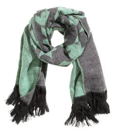 Soft jacquard-knit scarf. Size 23 1/2 x 70 3/4 in.