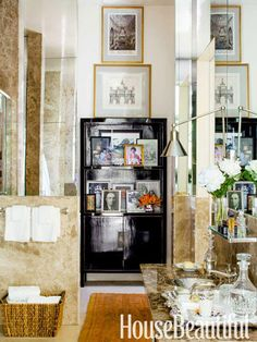 Family photographs in a master bathroom. Design: Alex Hitz. housebeautiful.com. #bathroom #photos