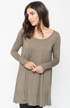 The slimming ribbed design + leg lengthening fit + flirty draped flow makes this every lady's go-to tunic. Perfectly paired with your everyday, neutral tones- this is an easy match for your comfortable leggings and favorite fall boots.COLORS BlackBrickOliveSIZES (This garment runs true to size) Small 0-4Medium 6-8Large 10-12Model is wearing a size Small92% Modal, 8% Spandex.Made in USA.