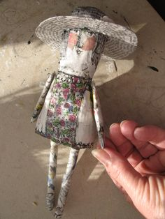 Papier mache art doll.  Love the use of printed paper combined with ink drawing.
