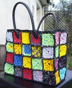 Wow! AGranny square tote made from strips of plastic bags. Such a great recycling project. The trick is to use bags of the same thickness and flexibility.  via la fille boheme