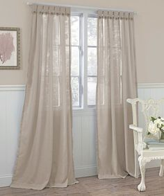 Put a finishing touch on any well-dressed room with this timeless curtain. The simple yet sophisticated panel is elegantly embellished with button tabs at the top and adds instant sophistication to the space.